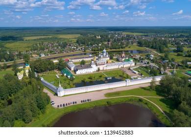 Tikhvinsky Bogorodichny Uspensky Monastery on a sunny July afternoon (aerial photography). Tikhvin, Russia