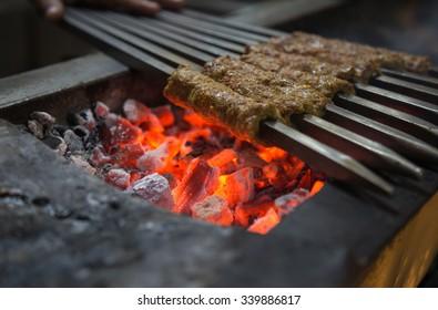 Tikka, shish, kofta kebabs on charcoal barbeque