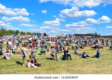 TIKKAKOSKI, FINLAND - JUN 16, 2018 : People waiting to see airshow at Finnish Air Force 100th Anniversary Airshow. Jets in background.