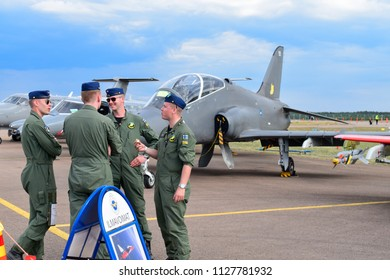 TIKKAKOSKI, FINLAND - JUN 16, 2018 : Group of pilot standing and talking in front of Hawk Jet fighter at Finnish Air Force 100th Anniversary Airshow