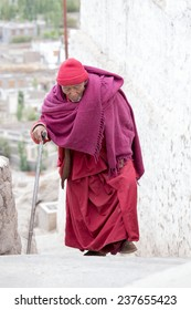 TIKSEY, INDIA - SEPTEMBER 08 2014: Old unidentified Tibetan Buddhist monk in the monastery of Tiksey in Ladakh. Tiksey is the oldest and largest Buddhist monastery in Ladakh, India