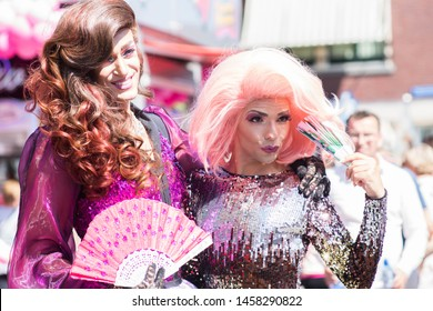 Tilburg, Netherlands - 22.07.2019: beautiful pair of transgender man in spectacular costumes at Roze Maandag, pink monday - gay, lgbt pride parade day in tilburg, Netherlands. Kermis 2019