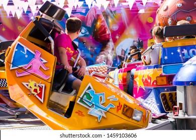 Tilburg, Netherlands - 2207.2019: people having a ride on break dance carousel in luna park, funfair called Kermis in Tilburg