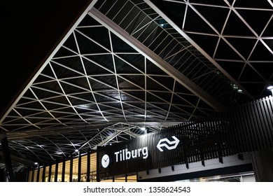 Tilburg, Netherlands - april 2 2019: the front facade of the new public transportation hub with busstation and trainstation in the city center of Tilburg. With a train station clock and the city logo.