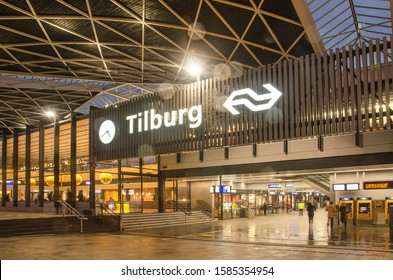 """Tilburg, The Netherlands, December 6, 2019: pedestrian passage under the railway station with its characteristic """"hyppar"""" roof on a rainy evening"""