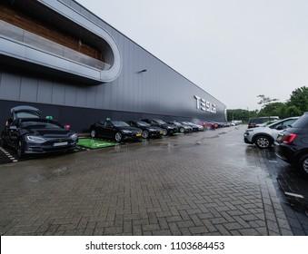 TILBURG, NETHERLANDS - MAY 31, 2018: New Tesla car Model S 100D before factory TESLA TILBURG.. Tesla Motors Assembly Plant in Tilburg, Netherlands. Tesla Model S 100D.