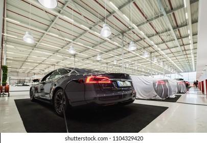 TILBURG, NETHERLANDS - MAY 31, 2018: New Tesla car in factory TESLA TILBURG.. Tesla Motors Assembly Plant in Tilburg, Netherlands. Tesla Model S 100D.