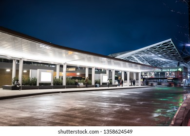 Tilburg, Noord Brabant, Netherlands - april 2 2019: Passengers awaiting their bus at the new public transportation hub with bus station and train station in the city center of Tilburg. Seen at night.