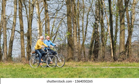 TILBURG-APRIL 7, 2019. Cycling elderly men enjoys spring weather. Holland has a population of 17 million people and 22 million bikes. The country has over 35,000 kilometers of dedicated bike paths.