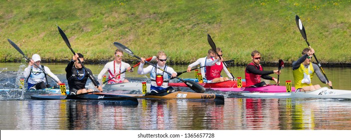 TILBURG-APRIL 7, 2019. A group of rowers from the student rowing club Vidar competing with each other in the Wilhelmina canal. Over the last decades, some Vidar members reached the Olympic level.