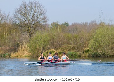 TILBURG-APRIL 7, 2019. A student rowing club Vidar female team in a four seat regatta on a tranquil Wilhelmina canal. Over the last decades, several Vidar members have reached the Olympic level.