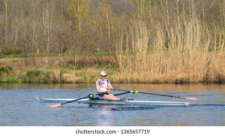 TILBURG-APRIL 7, 2019. A student rowing club Vidar member in a single seat regatta on a tranquil Wilhelmina canal. Over the last decades, several Vidar members have reached the Olympic level.