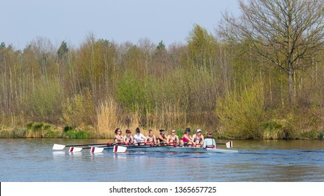 TILBURG-APRIL 7, 2019. A student rowing club Vidar female team in a nine seat regatta on a tranquil Wilhelmina canal. Over the last decades, several Vidar members have reached the Olympic level.