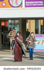 TILBURG-MARCH 10, 2017. Islamic women dressed in a chador. Body coverings are common in Islamic countries. Women who live outside these countries are not usually required to wear, but many still do.