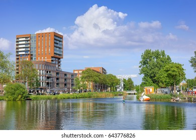 TILBURG-MAY 17, 2017. Pius harbor scenery, a vast area adjacent to the city center of Tilburg. The area is developed from a former industrial port, into a lively urbanized environment on the water.