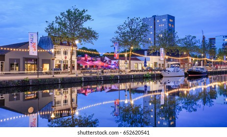 TILBURG-MAY 22, 2017. Pius harbor scenery at twilight, a vast area close to Tilburg city center. The area is developed from a former industrial port, into a lively urbanized environment on the water.