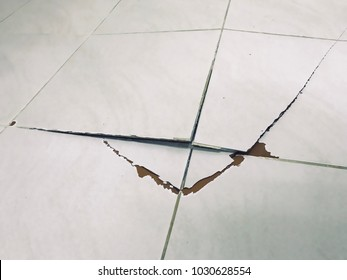 Tile floor exploded and cracked because used for a long time