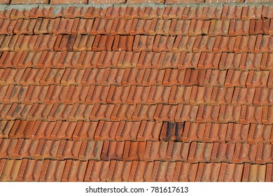Tile laid in rows as a roof element