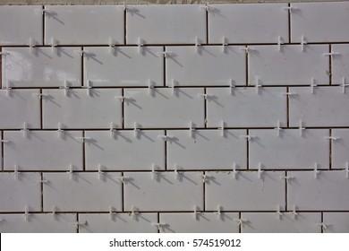Tile lying