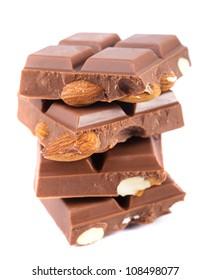Tile milk chocolate with almonds closeup on white