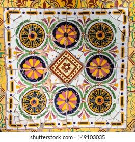 tile mosaic wall in park city Barcelona designed by Antoni Gaudi. Spain.