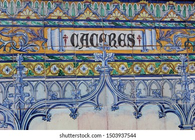 Tile with the name of the city of Cáceres. Located in Spain Square in Seville