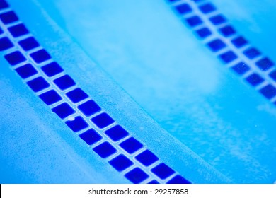 tile on steps of pool