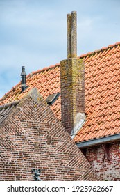 tile roof, brick wall and chimneys