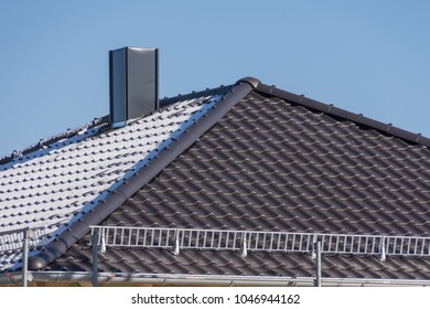 Tile roof of a new building in winter
