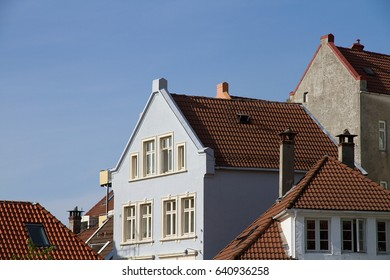 Tile roofs of Bergen in Norway in a bright summer day