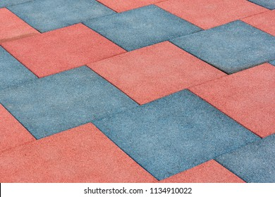 Tile of rubber crumbs on the playground. Square shape