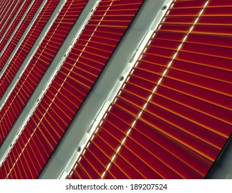 Tiled background - shutter in red