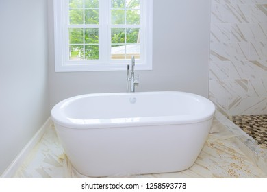 Tiled ceramic walls in bathroom, modern design with tiles. bathroom interior with minimalistic design idea of new bathroom
