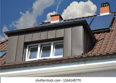 Tiled Roof with renovated Standing Seam Copper like coated Metal plated Dormer Window