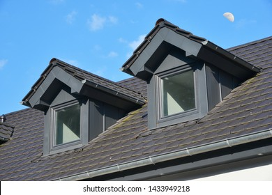Tiled Roof with renovated Standing Seam Metal Dormer Window