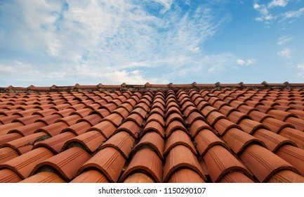 A tiled roof and the sky