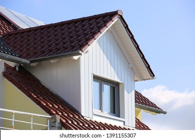 Tiled roof with wooden cladded dormer