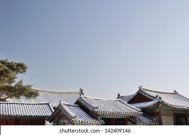 A tiled roofs and clear sky