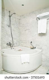 tiled shower with bathtub in hotel