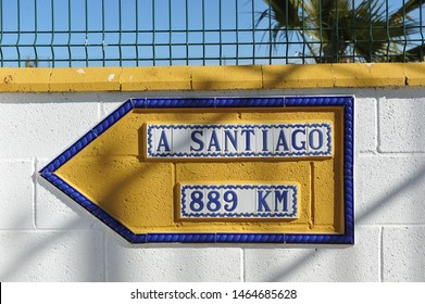 Tiled sign with the distance of 889 km to Santiago de Compostela in a country house on Via de la Plata near Fuente de Cantos, province of Badajoz, Spain
