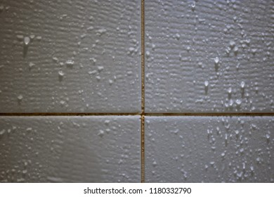 Tiled wall or floor with drops ow water, cleaning service framed background