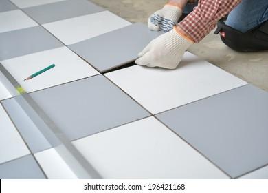 Tiler install ceramic tiles on  floor