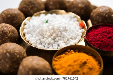 Tilgul or Til Gul with haldi Kumkum and halwa/chiranji or sugar balls for makar sankranti festival
