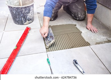 Tiling Floor & Wall. The tiler builder arranges the bathroom ceramics.