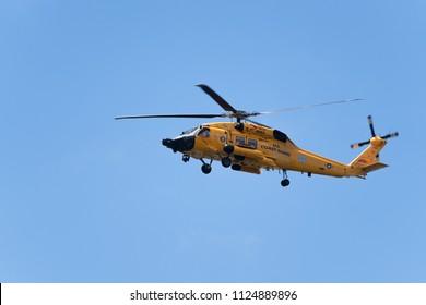 Tillamook, OR / USA - July 2 2018: U.S. Coastguard helicopter flying over Tillamook bay, Pacific Ocean.