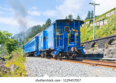 Tillamook, OR / USA - July 3 2018: Restro vintage style train carrying tourists along the pacific coast scenic route.