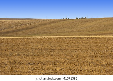 Tilled dirt field in the Colorado prairie in winter