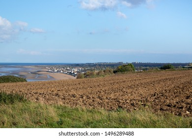 Tilled soil in a seaside agricultural field, in a farming concept