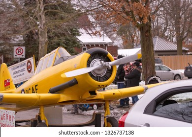 Tillsonburg, Ontario / Canada - November 17,  2018 :  Tillsonburg and Area Optimist Club Christmas Parade  showing a miniature Harvard aircraft from The Canadian Harvard Aircraft Association.