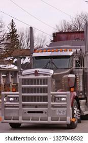 Tillsonburg, Ontario / Canada - November 17,  2018 :  Tillsonburg and Area Optimist Club Christmas Parade  showing a  semi truck with bush grill.